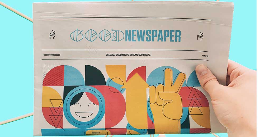 hand holding a good newspaper