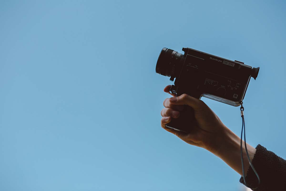 video camera against blue sky