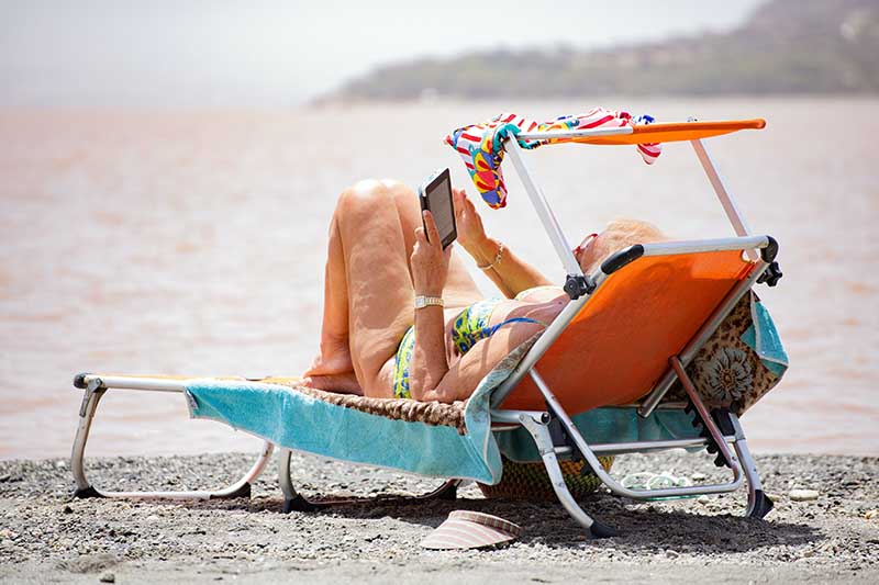 person on beach chair reading
